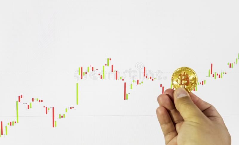 Financial growth concept with golden Bitcoins. On market chart background stock photo