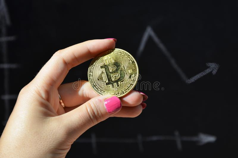 Financial growth concept with golden Bitcoins ladder on forex chart background. new virtual money. coin of crypto currency. electr. Onic money. female hand holds stock photography