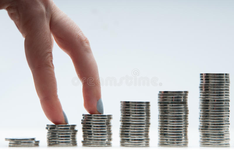 Financial growth. Concept with hands advancing on money steps stock photography