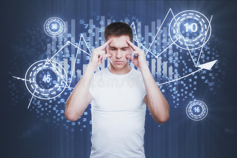 Financial growth concept. Pensive young european man on blue background with business charts and arrows. Financial growth concept stock photos