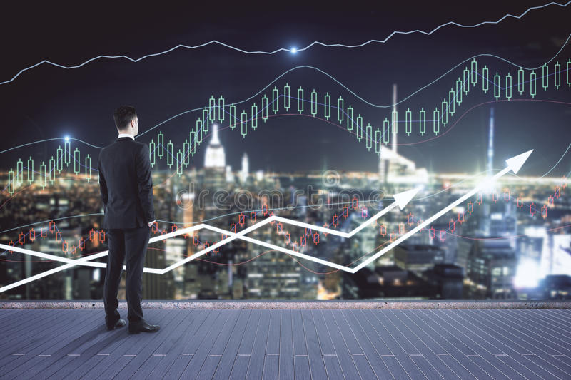 Financial growth concept. Young businessman on pier looking at night city with forex chart. Financial growth concept stock photos