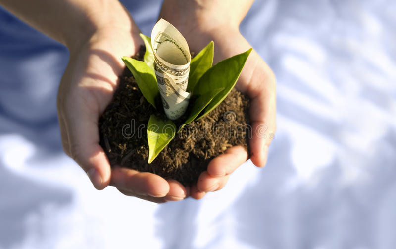 Financial growth. Hands with money depicting financial growth. Business is growing stock image