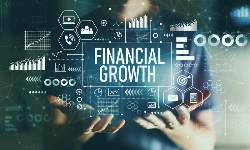 Financial growth with young man. In the night royalty free stock photography