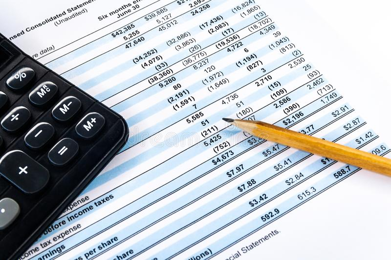 Financial income statement with calculator and pencil. Accounting business concept. Calculator with accounting report and financial statement on desk, finance stock images