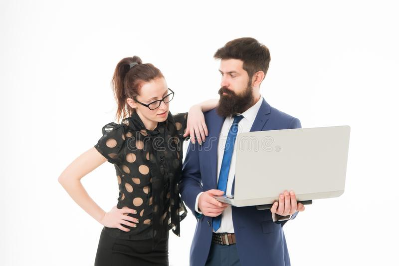 Financial indicators. Couple working using laptop. Business lady check what is done. Lady boss satisfied with business. Indicators. Manager show result. Report stock photography