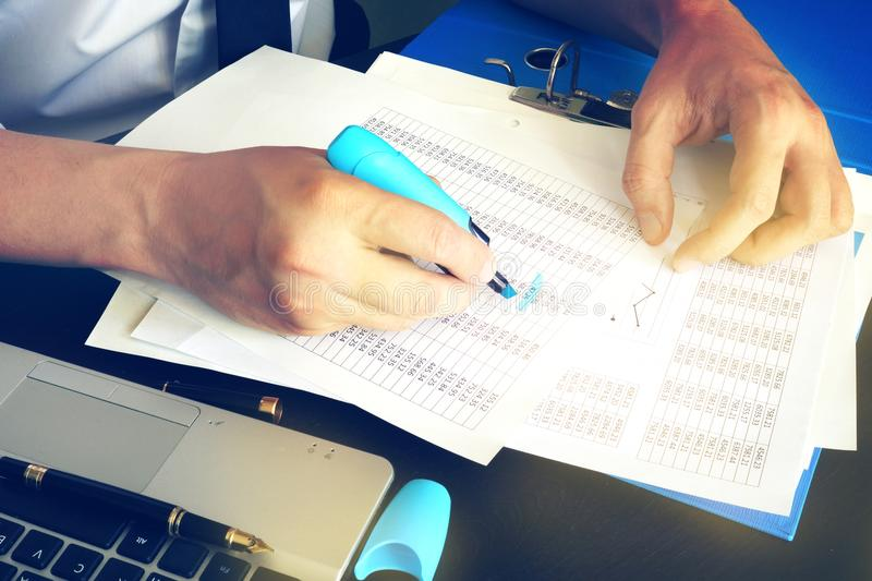 Financial inspector or accountant checking balance. royalty free stock photography
