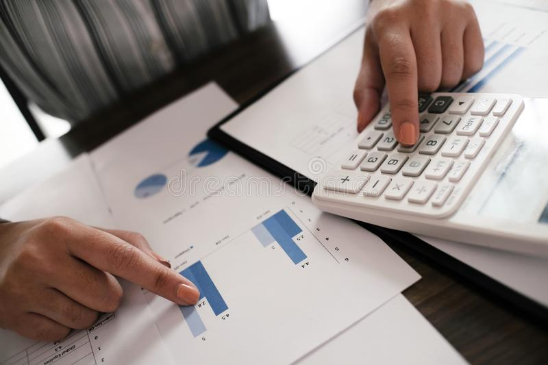 Financial inspector making report, calculating or checking balance. Business Audit concept royalty free stock photography