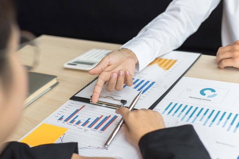Financial and investment planning, Head of Marketing is analyzing data from the summary graph statistics for executives, business. Meetings stock photography