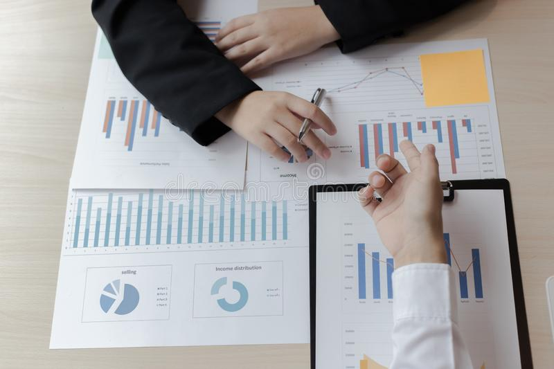 Financial and investment planning, Head of Marketing is analyzing data from the summary graph statistics for executives, business. Meetings stock image