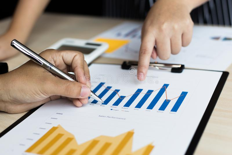 Financial and investment planning, Head of Marketing is analyzing data from the summary graph statistics for executives, business. Meetings royalty free stock photo