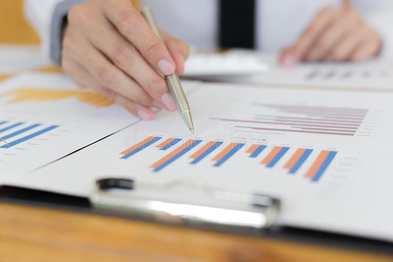 Financial and investment planning, Head of Marketing is analyzing data from the summary graph statistics for executives, business. Meetings royalty free stock photography