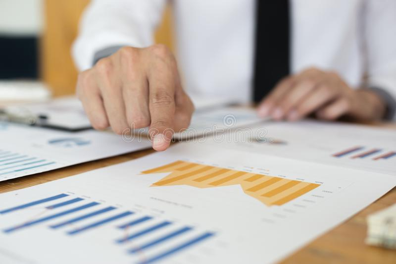 Financial and investment planning, Head of Marketing is analyzing data from the summary graph statistics for executives, business. Meetings royalty free stock image