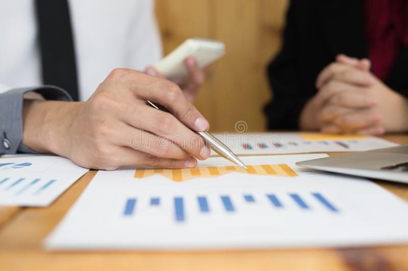 Financial and investment planning, Head of Marketing is analyzing data from the summary graph statistics for executives, business. Meetings royalty free stock photos