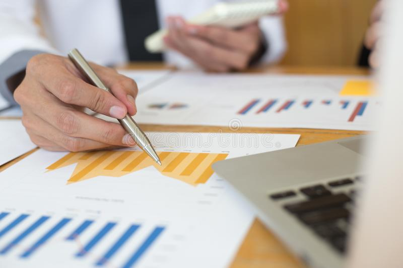 Financial and investment planning, Head of Marketing is analyzing data from the summary graph statistics for executives, business. Meetings stock photo