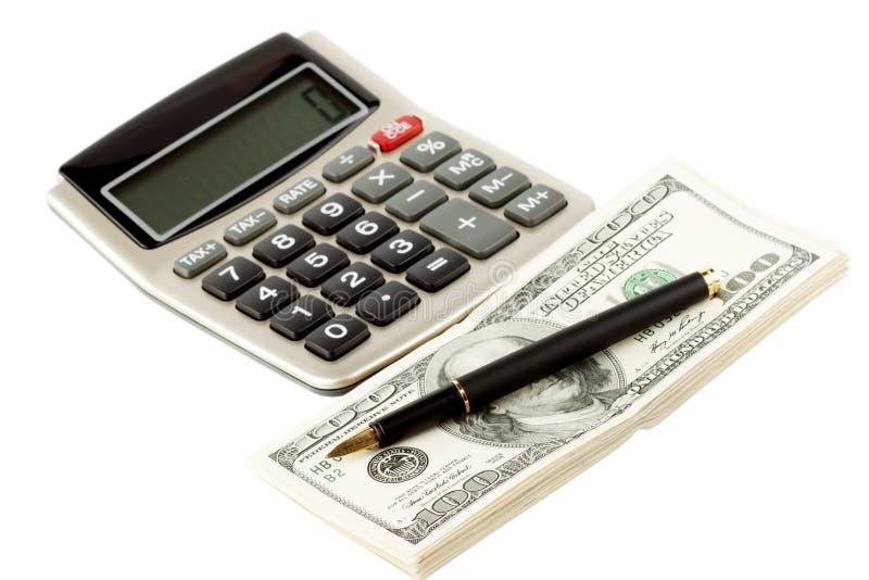 Financial Literacy. Closeup Pen, calculator and cash royalty free stock photos