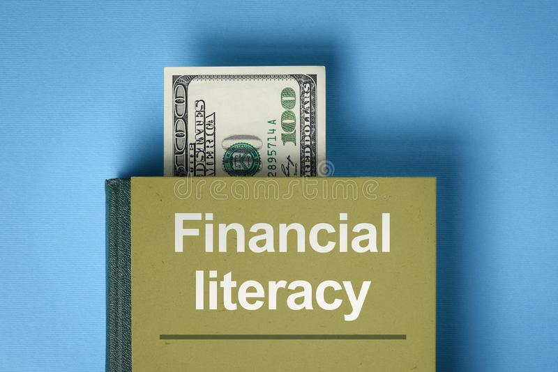 Financial literacy concept. The concept of financial literacy. A book with knowledge about money and investments. Bookmark from the dollar bill royalty free stock photo