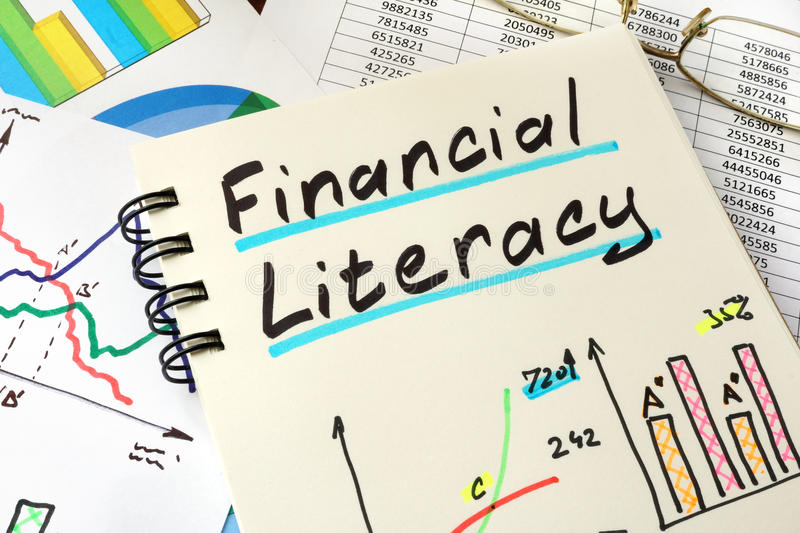 Financial Literacy. Financial Literacy written on a notepad sheet. Education concept royalty free stock photography