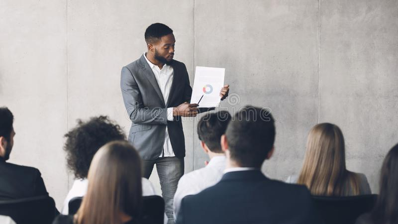 Financial manager making presentation, showing diagram, free space stock photography