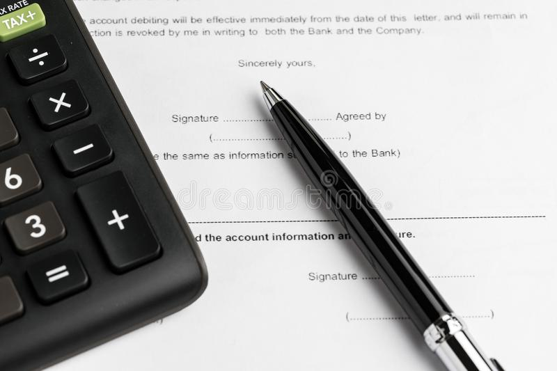 Financial money loan, mortgage or buy and sell contract with ban. K, printed paper form with pen to sign and calculator royalty free stock photo