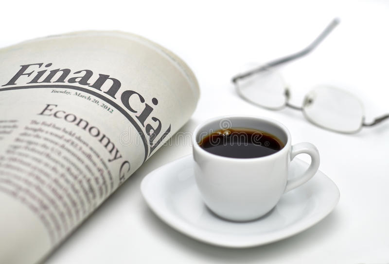 Financial newspaper with coffee stock images