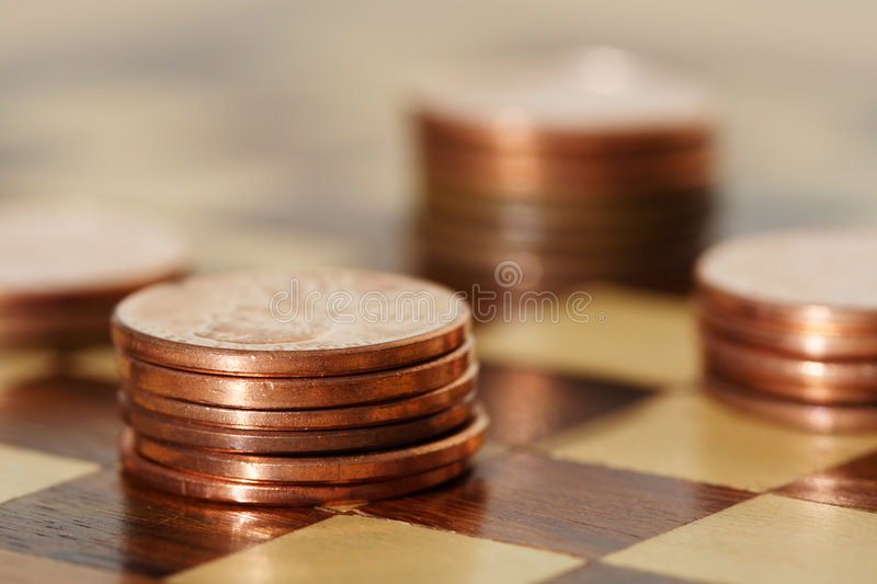 Financial planning. Using a chess board royalty free stock photo