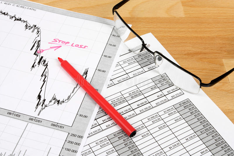 Financial planning. Business composition with finance charts, stock market graph analysis and glasses royalty free stock image