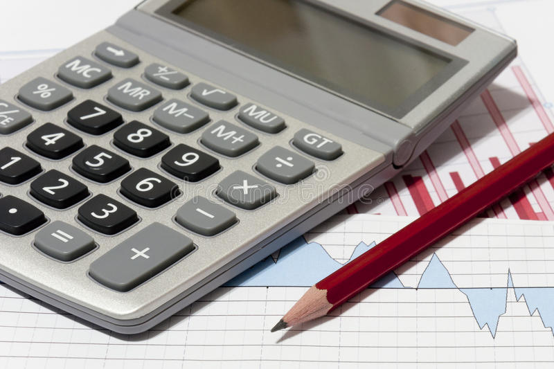Financial planning. With calculator and pencil stock image