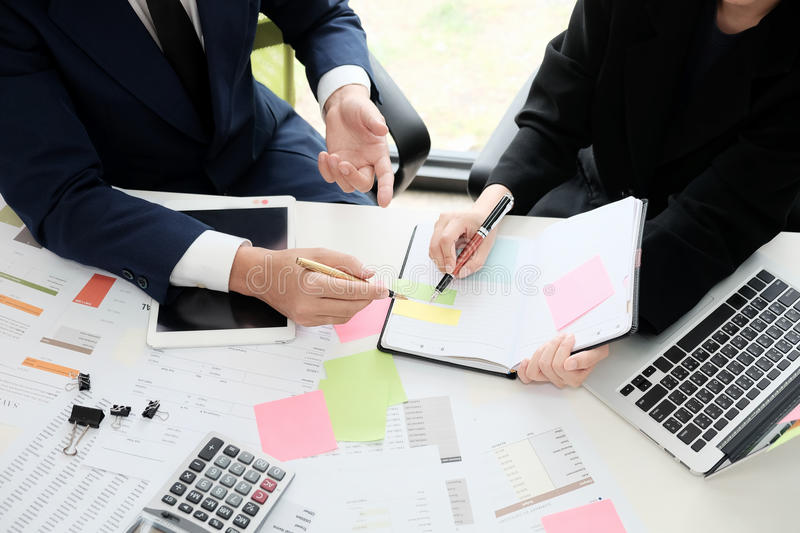 Financial planning Business man and Business woman talking to pl. Anner financial business, report finance in paper on office accounting desk stock image