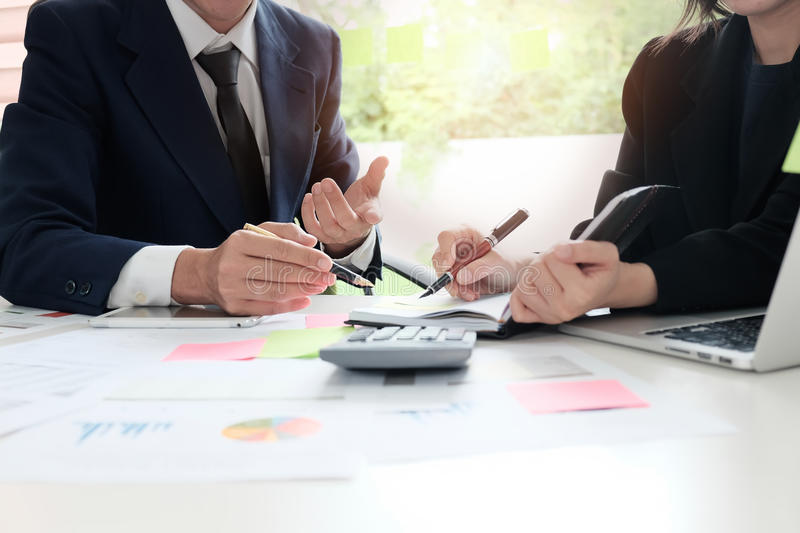 Financial planning Business man and Business woman talking to pl. Anner financial business, report finance in paper on office accounting desk stock photo