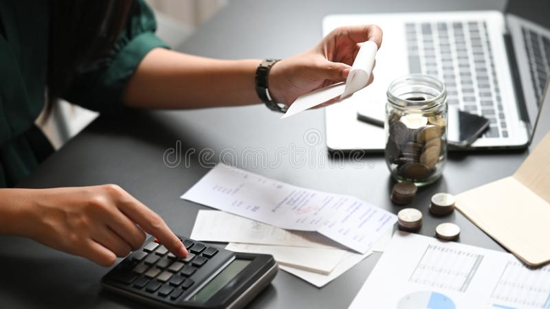 Financial planning concept, Closeup woman calculate billing with finance home. saving. Financial planning concept, Closeup woman calculate billing with finance royalty free stock photo