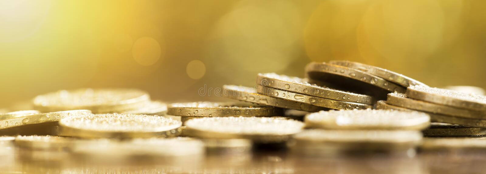 Financial planning - gold money coins banner. Financial planning concept - gold money coins, web banner with copy space stock photography