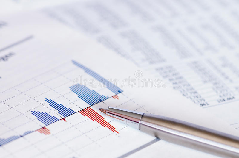 Financial planning with stock chart and pen. royalty free stock photography