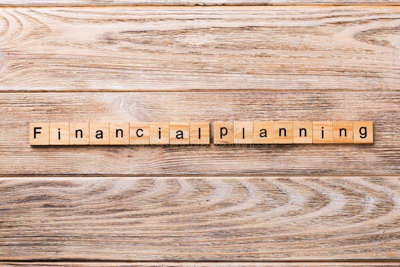 Financial planning word written on wood block. financial planning text on wooden table for your desing, concept.  stock photos