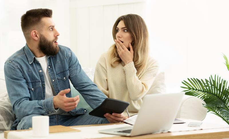 Young Couple Managing Family Budget, Calculating Expenses stock photos