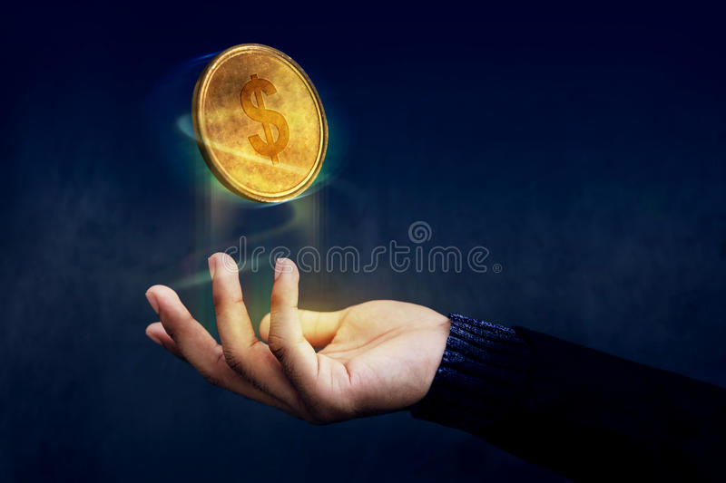 Financial or Profit as Easy Concept, Golden Money Coin float over Magician hand like a Magic, Dark light stock image