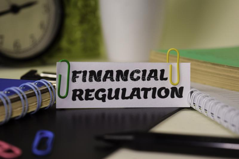 Financial Regulation on the paper isolated on it desk. Business and inspiration concept royalty free stock photo