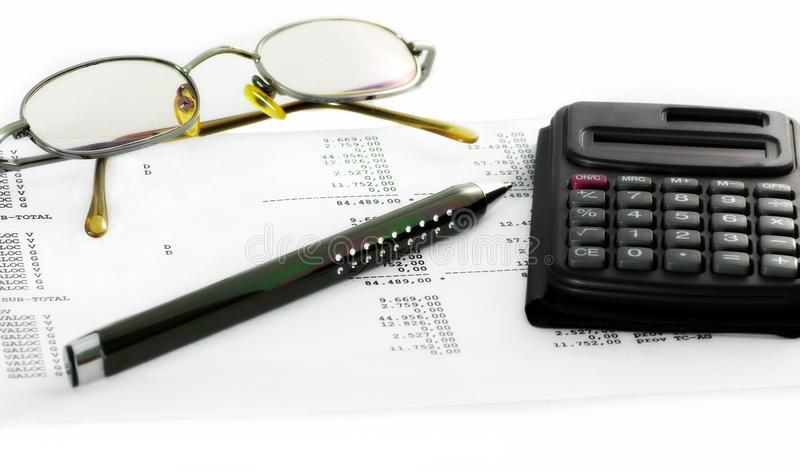 Financial report in Department of Accounting, Reporting and Analysis. Calculator, pen and glasses placed on financial report in Department of Accounting royalty free stock images