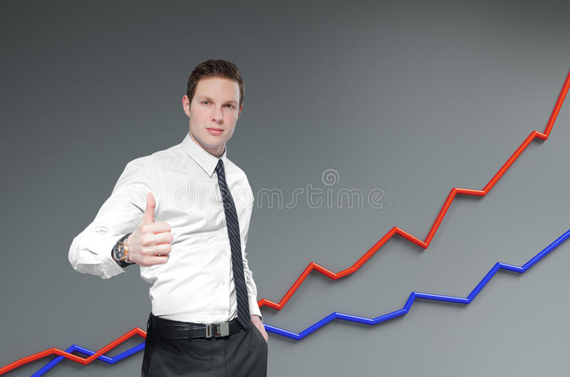 Financial report & statistics. Businessman shows thumb up. stock photo