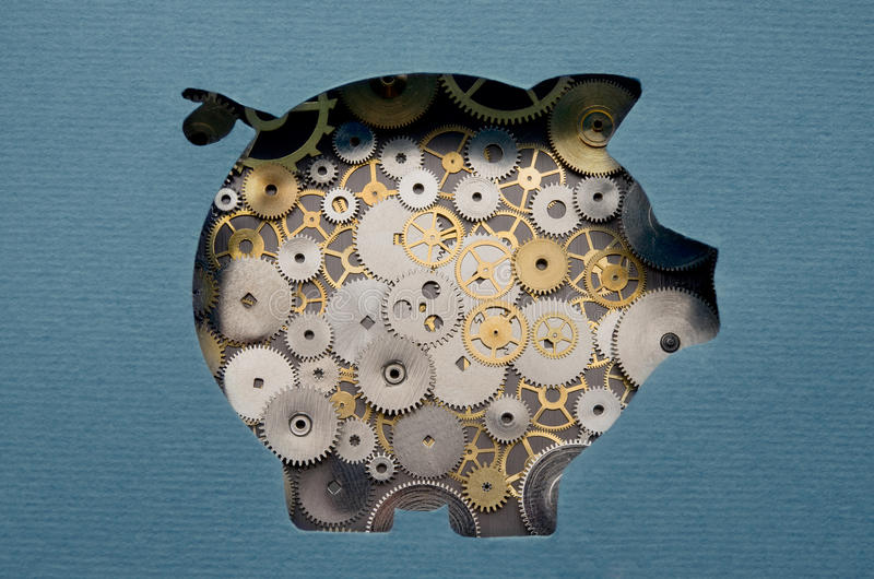 Financial savings mechanism. Piggy bank formed by gears and cogs stock photos