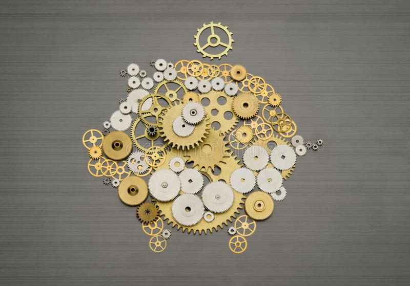Financial savings mechanism. Piggy bank formed by gears and cogs royalty free stock photography