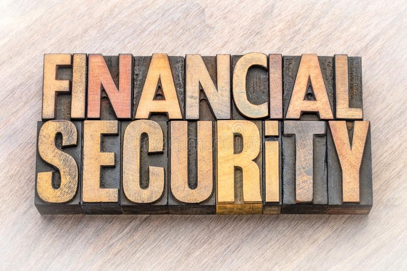 Financial security word abstract in wood type. Financial security - word abstract in vintage letterpress wood type blocks stock photo