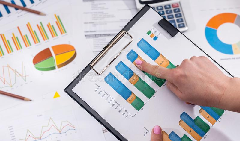 Businesswoman analytics financial accounting market chart or diagram. stock photography