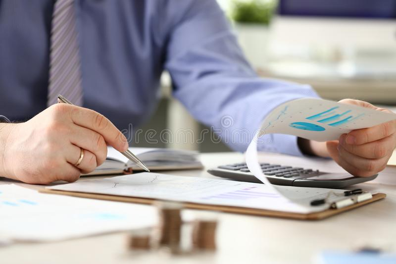 Financial Tax Report Man Calculating Vat Expenses. Professional Bookkeeper Checking Debt Paper Graph. Audit Concept. Businessman Counting Money Using royalty free stock images