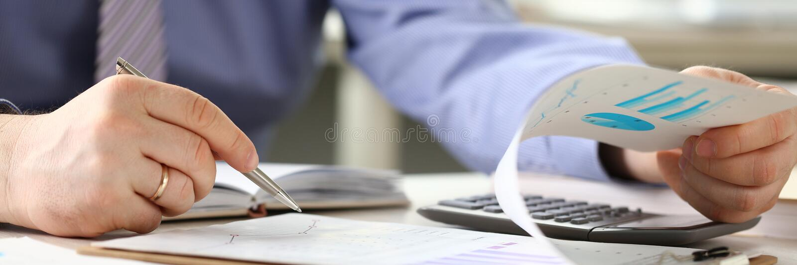 Financial Tax Report Man Calculating Vat Expenses. Professional Bookkeeper Checking Debt Paper Graph. Audit Concept. Businessman Counting Money Using stock images