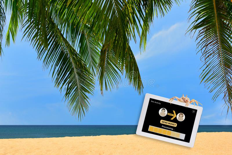Financial technology and peer to peer transfer money on tropical beach background stock images