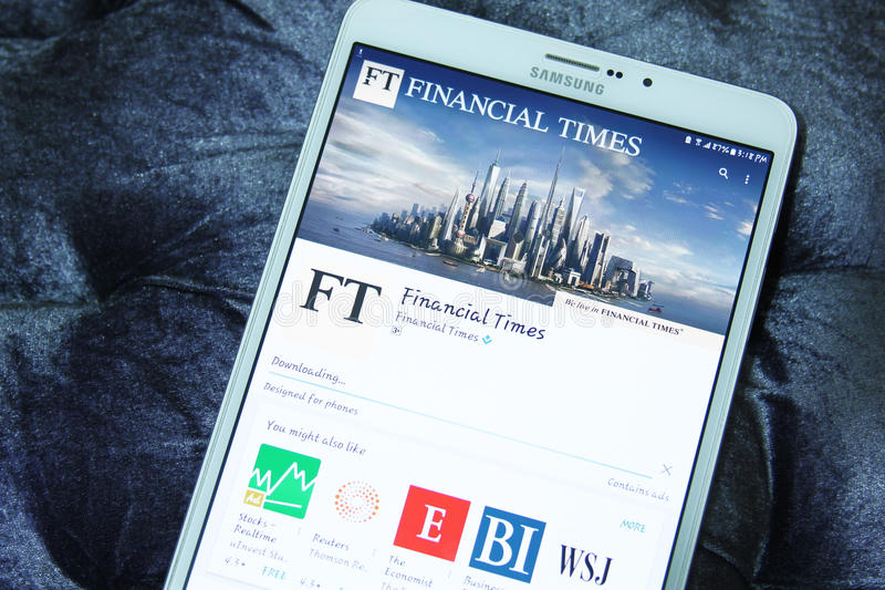 Financial Times mobile app. Downloading Financial Times application from google play store on samsung tablet. The Financial Times FT is an English-language stock photo