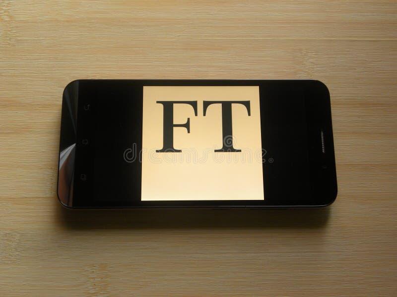 Financial Times på mobiltelefonen royaltyfri foto
