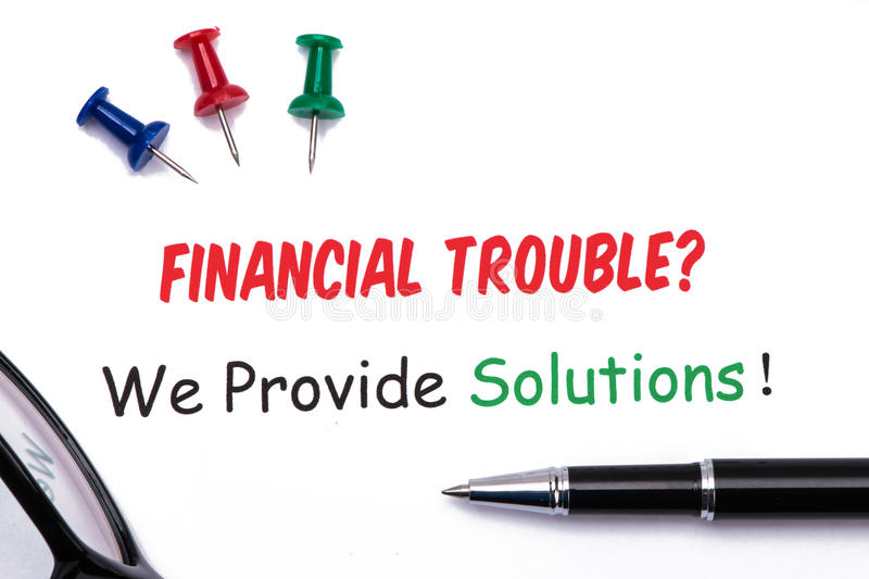 Financial troubles?we provide solutions!. On white paper royalty free stock photography