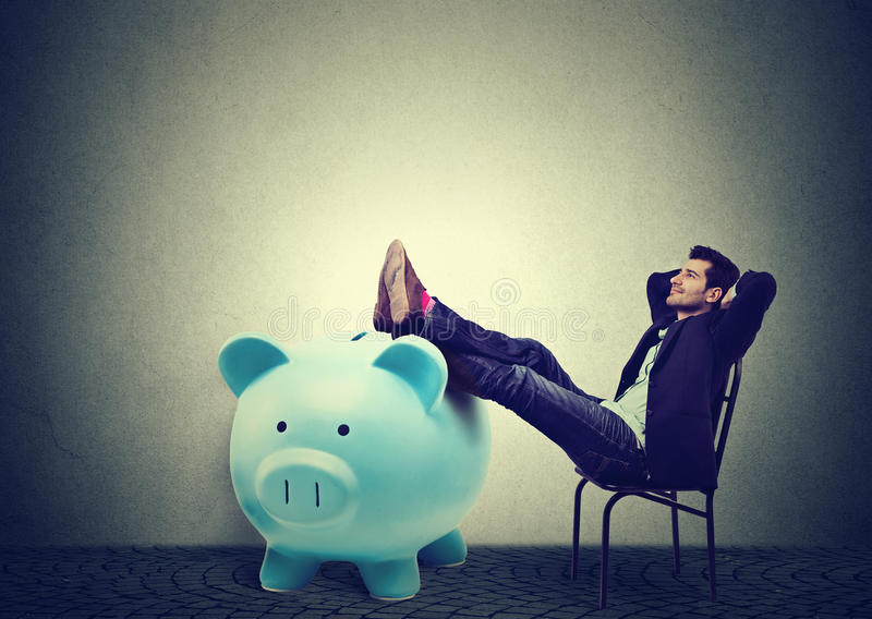Financially successful business man sitting relaxing in chair royalty free stock photo