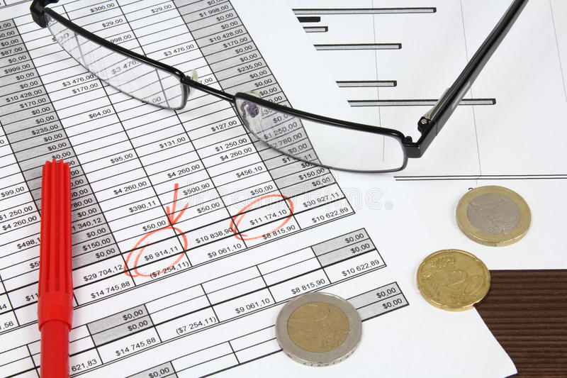 Financials. Business composition. Financial analysis - income statement, Euro money and a red pen stock images